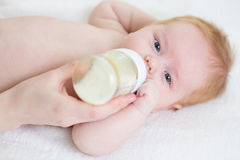 Baby infant feeding from bottle Royalty Free Stock Images