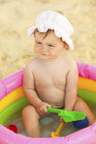 Baby in the inflatable swimming pool. Portrait of cute little baby girl in the inflatable swimming pool royalty free stock photo