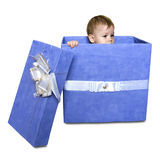 Baby inside a gift box isolated on a white background Royalty Free Stock Images