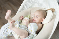 Baby inside the house having good time royalty free stock photography