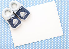 Baby invitation card. With baby blue shoes and blue polka dot background Royalty Free Stock Photos