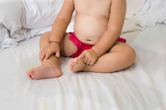 Baby involuntary urination during sleep ,Bedwetting Royalty Free Stock Photos