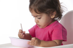 Baby isst durch  Lizenzfreies Stockbild