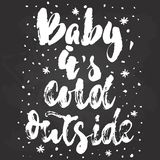 Baby, its cold outside - hand drawn Christmas and New Year winter holidays lettering quote isolated on the black. Chalkboard background. Fun brush ink Stock Image