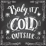 Baby its cold outside hand-lettering sign Stock Photo