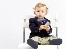 Baby in jasje en vlinderdas royalty-vrije stock fotografie
