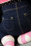 Baby in jeans Stock Images