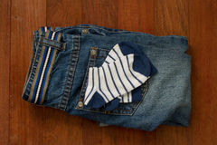 Baby jeans and socks Stock Image
