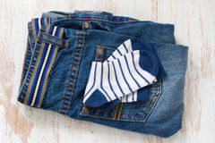 Baby jeans and socks Stock Photos