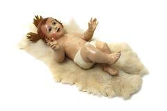 Baby jesus. Figure of baby jesus on white background royalty free stock photo