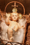 Baby Jesus. Antique Plaster Baby Jesus in the Manger (closeup of a Nativity scene Royalty Free Stock Photo
