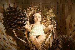 Baby Jesus in the crib Christmas card Royalty Free Stock Photo