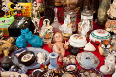 Baby Jesus doll and other vintage things for sale on flea market Stock Photos