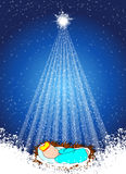 Baby Jesus in the manger. Baby Jesus with stars on blue background Stock Photos