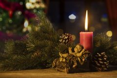 Baby Jesus Statue With A Burning Candle Royalty Free Stock Images