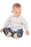 Baby just sits on the floor Stock Images