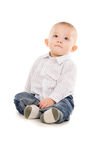 Baby just sits on the floor Royalty Free Stock Photography