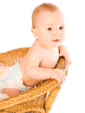 Baby keeps on chair back Stock Photo