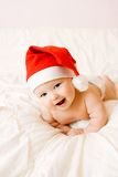 Baby in Kerstmishoed royalty-vrije stock afbeelding