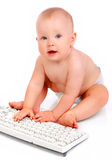 Baby with  keyboard Royalty Free Stock Images