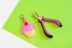 Baby keychain. Felt cupcake. Handmade felt keychain for handbag or briefcase Stock Photo