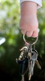 Baby Keys. A little baby hand holds the car keys Royalty Free Stock Image