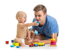 Baby kid boy and father playing together Stock Image