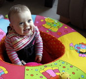 Baby kid in playpen laughing Stock Image