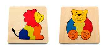 Baby and kid puzzle lion and bear - isolated on white background Royalty Free Stock Photos