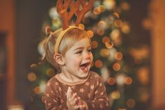 Baby on kid`s Christmas party royalty free stock images