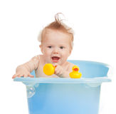 Baby kid taking bath and playing Royalty Free Stock Images