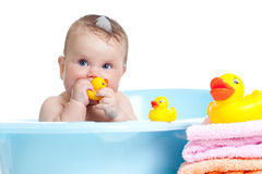 Baby kid taking bath and playing Stock Images