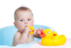 Baby kid taking bath and playing Royalty Free Stock Image