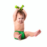 Baby kid, toddler in green diapers  doing exercises with dumbbel Royalty Free Stock Photos