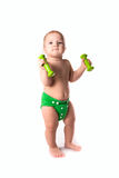 Baby kid, toddler in green diapers  doing exercises with dumbbel Royalty Free Stock Images