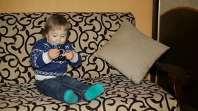 Baby kid using smartphone. At home stock video