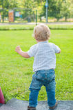 Baby kid walking on the green grass Stock Photography
