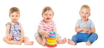 Baby Kids Sitting on White, Beautiful Toddler Children with Toy royalty free stock images