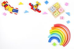 Baby Kids Toys Background. Wooden Educational Geometric Stacking Blocks Toy, Rainbow, Airplane, Train And Colorful Royalty Free Stock Photos