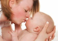Baby kiss Stock Photos