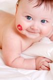 Baby and kiss Stock Images