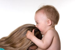 Baby kisses his mother. Royalty Free Stock Photo