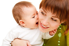 Baby kissing mother stock images