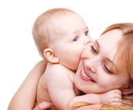 Baby kissing mother Stock Photo