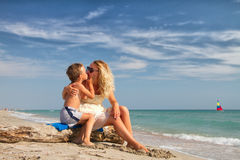 Baby kissing mother Royalty Free Stock Images