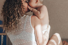 Baby is kissing mother Royalty Free Stock Photos