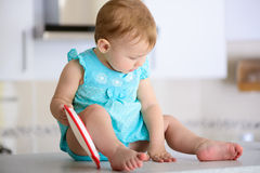 Baby in kitchen Royalty Free Stock Photography