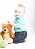 Baby Kneeling with Teddy Bear On White Stock Photos