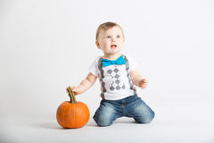 Baby on Knees Holding Pumpkin Stem Royalty Free Stock Photography