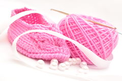 Baby knitted booties. Royalty Free Stock Photo